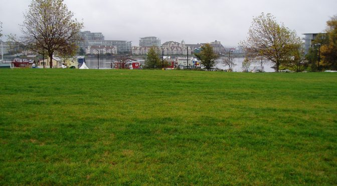 An open grassy areaa looks out at Fishernan's Wharf, Victoria, Vancouver Island, BC, Pacific Northwest garden